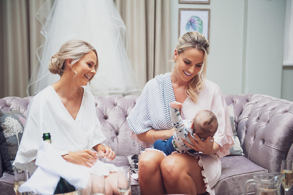 Bride and bridesmaid with baby