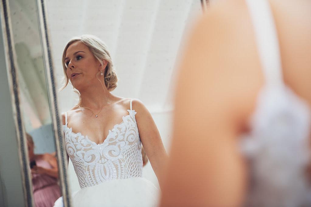 Bride nervous in mirror