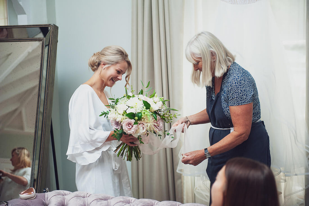 Bride accepting flowers