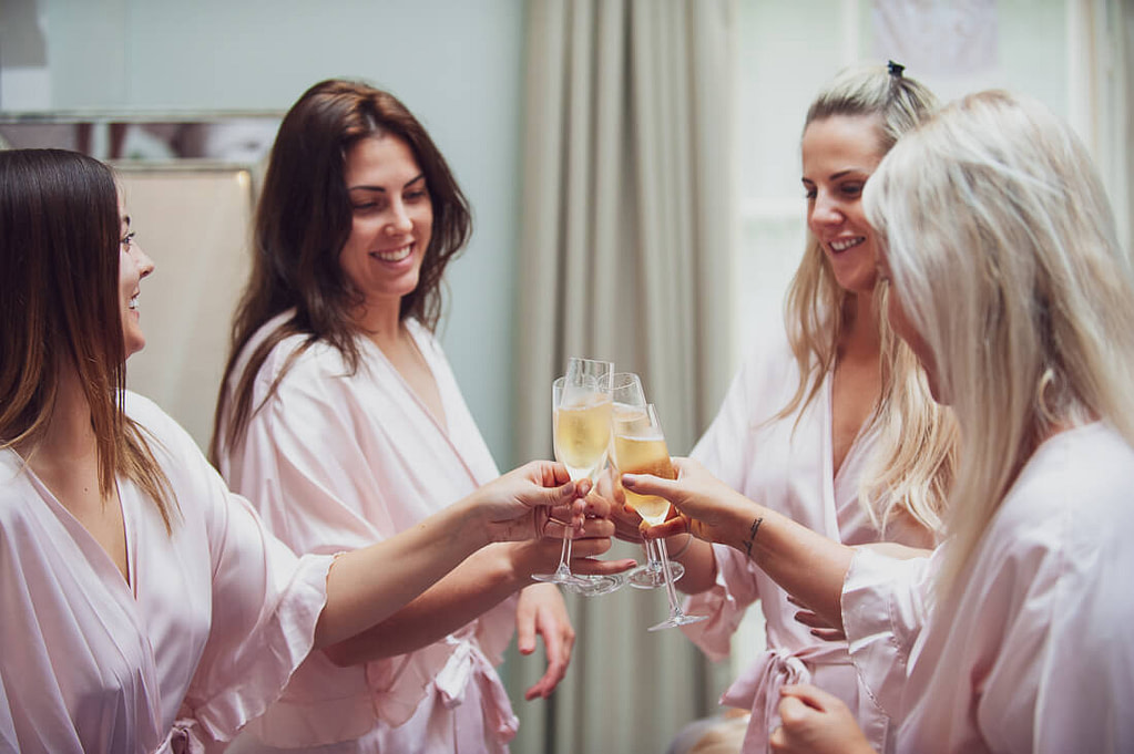 Bridesmaids clinking glasses