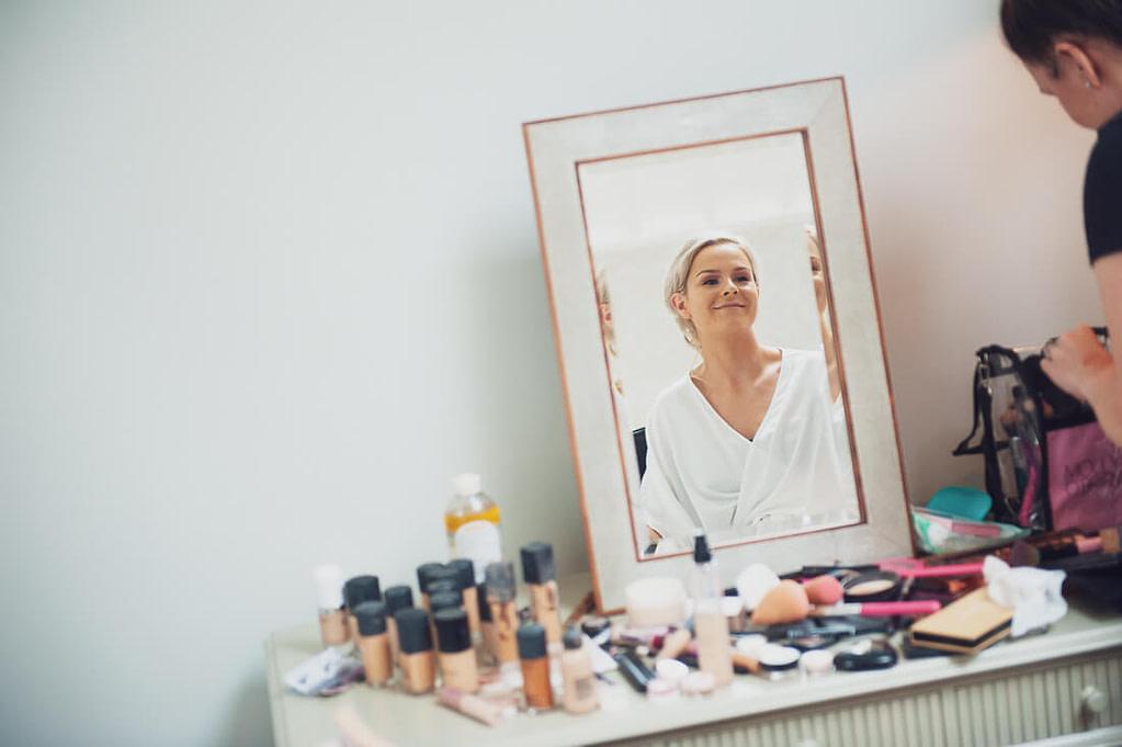 Bride happy in mirror