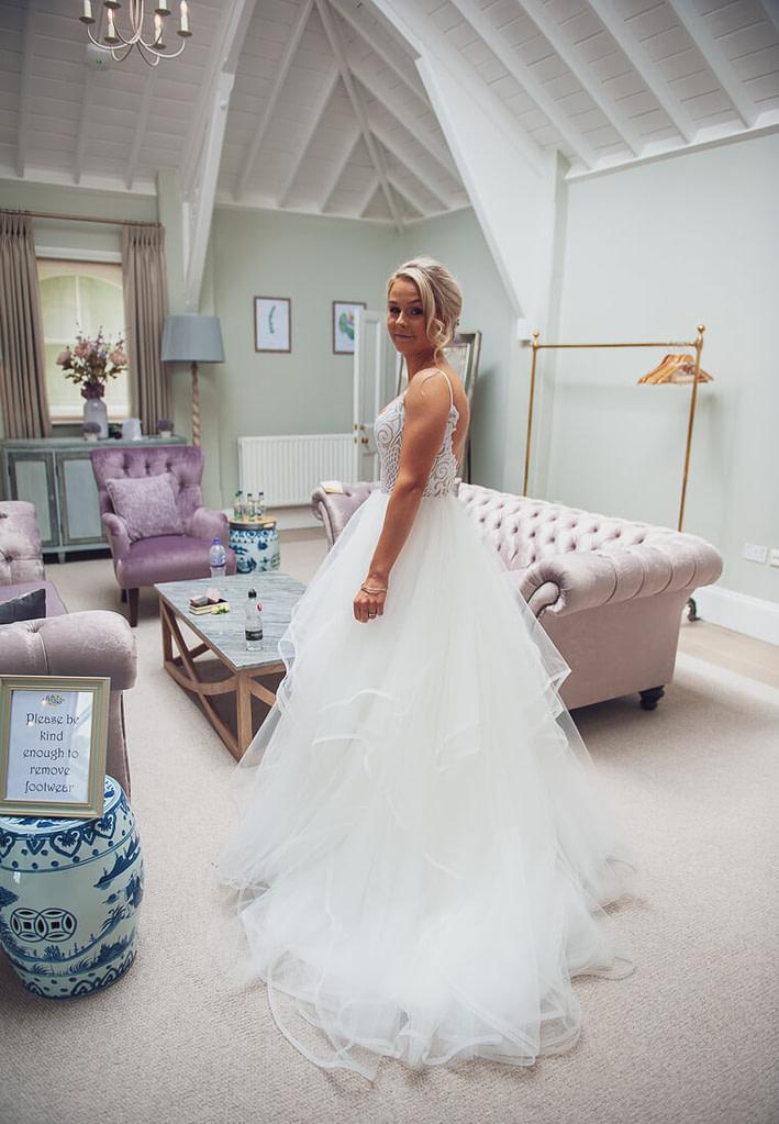 Bride posing in prep room