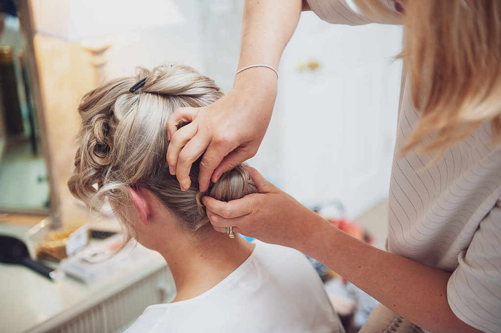 Hairdresser doing brides hair